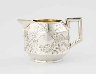 angular design--angular handle and spout; pointed shoulder; decorated with Asian-style designs of cranes, bamboo, fan shapes, the moon and flowers
