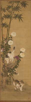 cat on ground looking up to cat on rock above at L, amid bamboo; purple and white chrysanthemums