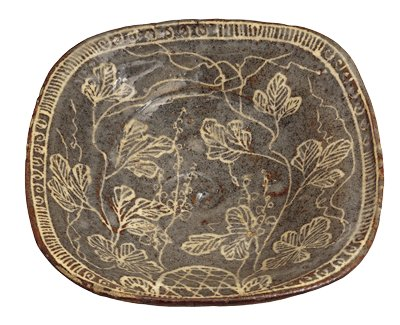 bowl with rounded square shape with rounded corners; three small square feet; blue-grey with white slip design of twining flowers; arc-shaped trellis (?) at one side; lines and scrolls around border; deep swirl at bottom center