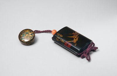 inro with four sections, depicting three cranes flying together to UR; stylized lines on opposite side, reminiscent of clouds or waves; presently connected with purple cord, orange ojime, and black lacquered netsuke