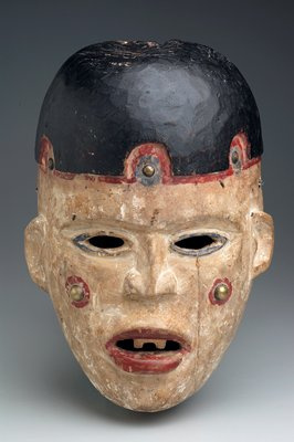 human face with white skin; blue-rimmed eyes; red parted lips with 2 white teeth; black hair with red and blue on forehead; red spots on cheeks