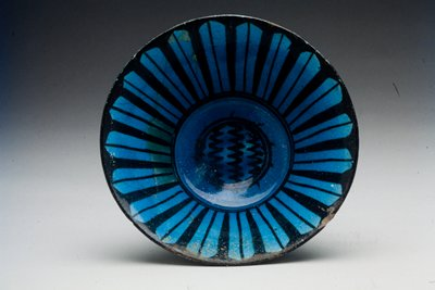 Bowl, radial stripes in black under blue glaze.