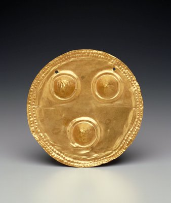 Breast Plaque of beaten gold.  Three breast motifs.  From Sona region of Veraguas Province, Panama.