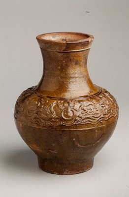 Wine Jar (Hu), decorated with molded relief band containing running and contending animals and two Ta'o-Ti'eh masks with fastening rings; reddish clay, brownish glaze