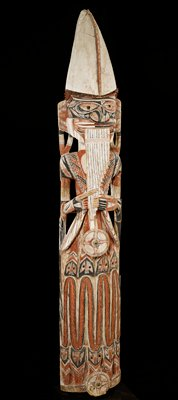 standing figure with panpipes encircled by serpents and birds; wood with opercula inserts and pigments; carved for Malanggan rites