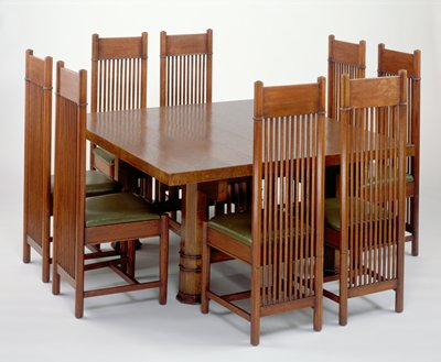 Four heavy octagonal legs with casters; legs on short sides connected by a screen of four-sided spindles; long octagonal spindles connect screens