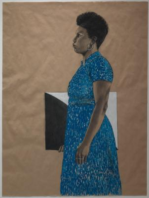side portrait of black woman with short hair in a blue dress and silver hoop earrings with three rings on her PL hand; the woman is holding a rectangle in her PR hand that is half black and half white, split along a curved diagonal line