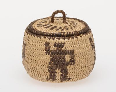 Miniature round basket with cover; coiled. Design consists of four human figures. Colors are natural and black.