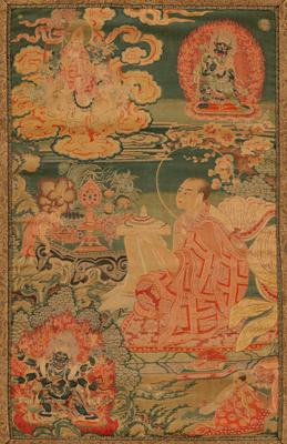 Brocaded panel of polychrome design with young Buddha in a light red robe making offering to the Queen of Heaven. Framed by later brocade, possibly Japanese. The treatment of the subject is similar to Tibetan Buddhist paintings; Tibetan-type altar hanging probably executed by Chinese artisans; Mkhas-grub Rje (founder of the Gelukpa order of Tibetan Buddhism) is shown making a mandala offering to his great teacher (Tsong-ka-pa), who sits above on a white elephant surrounded by clouds; a fellow monk assists Mkhas-grub Rje while the six-armed guardian Mahakala occupies the lower left corner; upper right depicts Yamantaka with his consort. Former Classification: Textiles - Tapestry