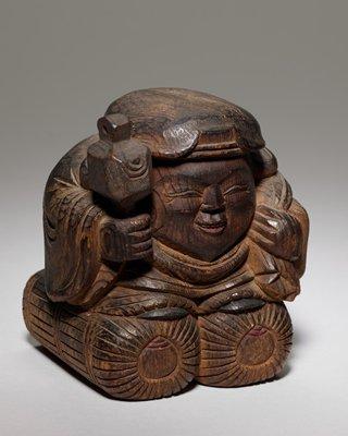 one of a pair of auspicious folk art figures: Daikoku and Ebisu; man with hammer and sack