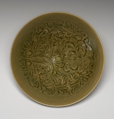 wide bowl with carved floral decoration on interior; green glaze