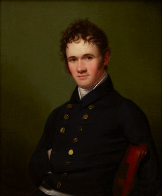 Portrait of a man, waist-length, seated.