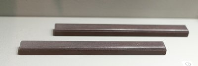 rectangular bar with beveled top edge