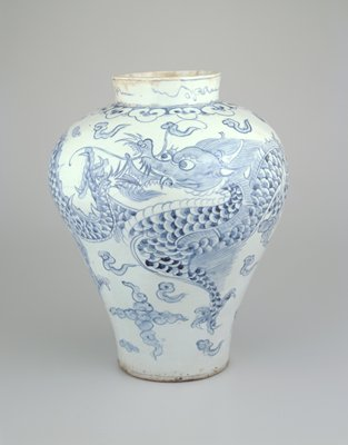 wide, flaring shoulder with short, wide neck; blue and white glaze with 2 dragons, cloud forms and scrolls around neck