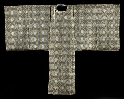 geometric pattern; robe with floral shapes and medallions in octagons and squares; cream-colored tie; white, tan and blues