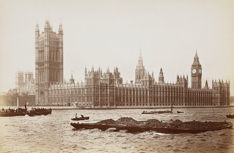 Houses of Parliament; coal barge in foreground, paddlewheel ferry on left in river