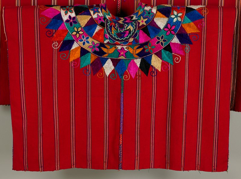 red with thin multicolored stripes; embroidered neckline with birds, flowers, feather and triangle designs in bright colors