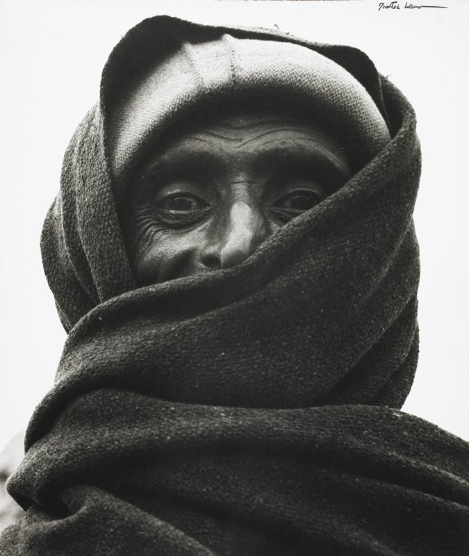 head and shoulders image of tribesman, fabric wrapped around head and shoulders leaving only eyes and nose visible