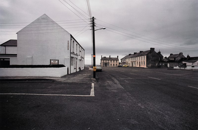 Kincora Bed & Breakfast; village street leading to the sea; power pole and lines