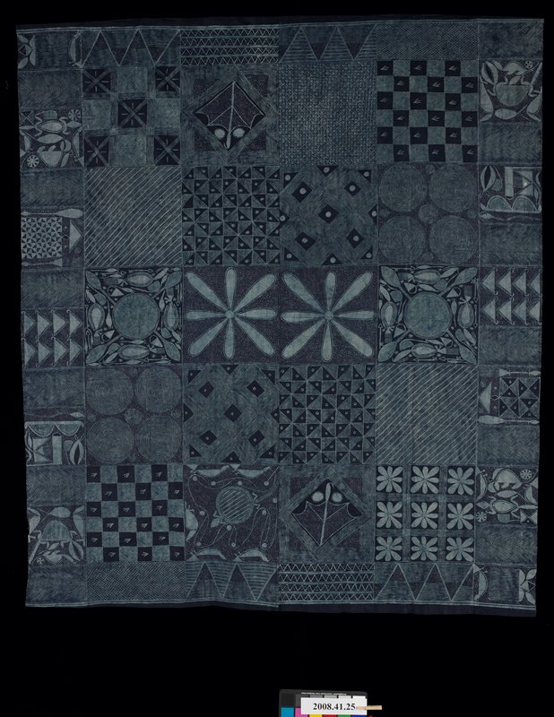 two panels sewn together and hemmed on two sides; indigo with light blue patchwork- like designs with geometric patterns, organic animal motifs and abstracted flowers; starch resist