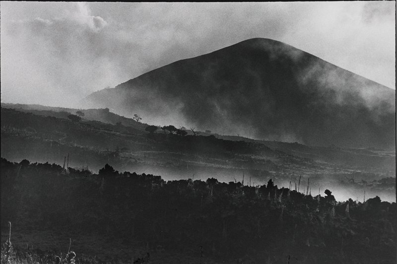 landscape, Mauna Kea with clouds and fog(?) or steam(?) above and around mountain