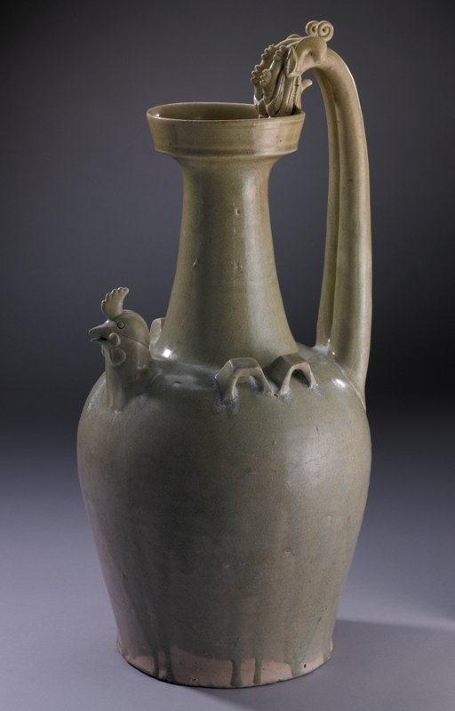 green glaze; rounded shoulder; flat bottom; long neck, tapering and flaring out at top to ring mouth; two-part handle with two dragons' heads with their mouths around edge of mouth opening on spout; small chicken head with slightly open beak as pouring spout; four squared-off loops at shoulder- two on each side