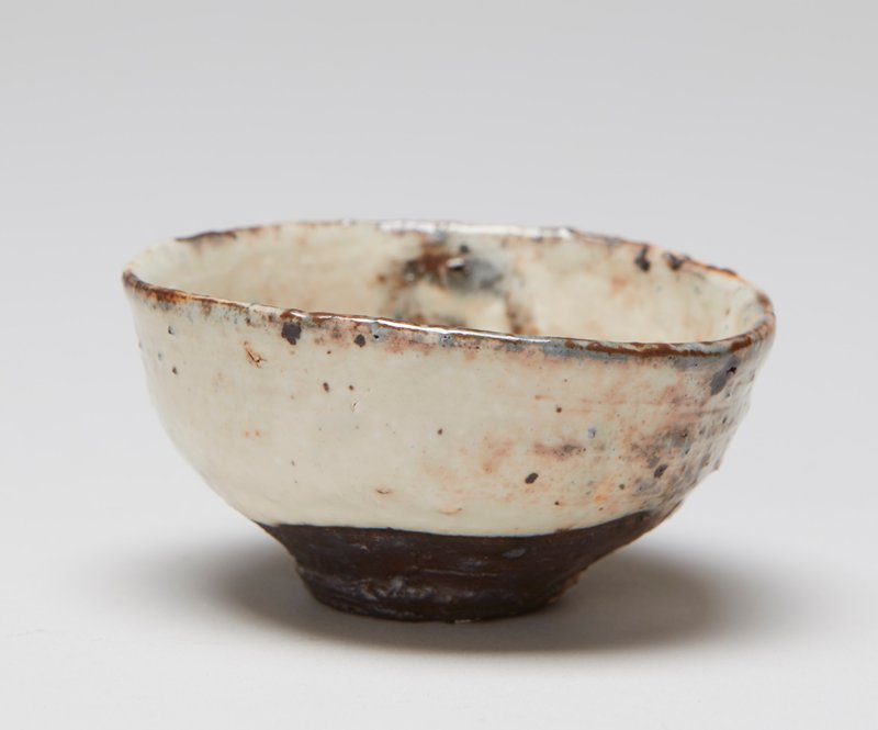sake cup; small foot; dish-shaped, with sides slightly flattened; grey bottom; white and brown glaze