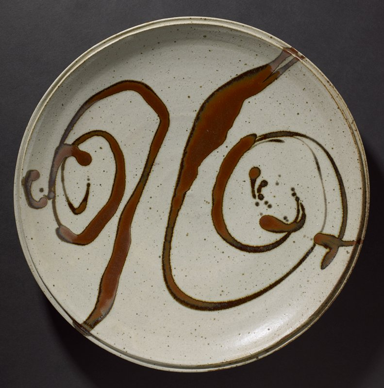 very large, heavy round platter; ring foot; double rim; grey with brown spots and two brown dripped spirals on top