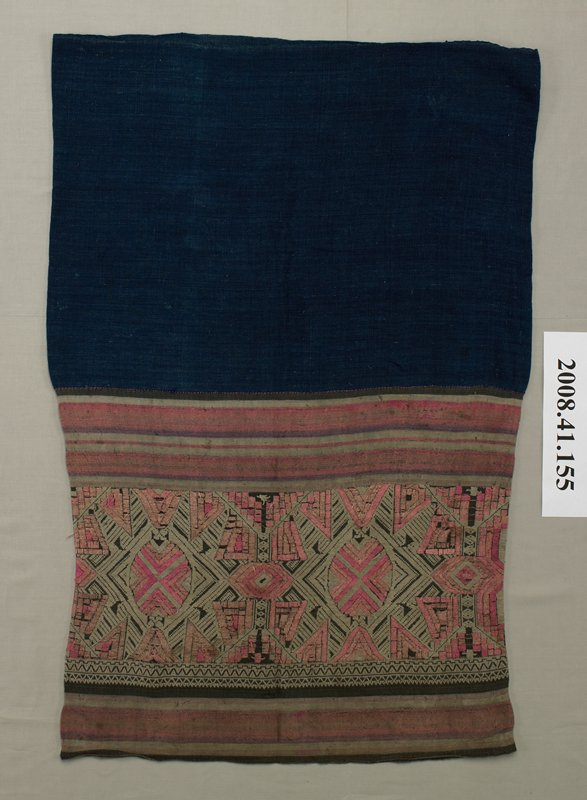 dark blue skirt with embroidered panel and horizontally striped fabric at top; embroidered panel in pink, gray and brown in geometric patterns; pink, gray and brown striped panels above and below embroidered panel; solid dark blue fabric panel at bottom of skirt