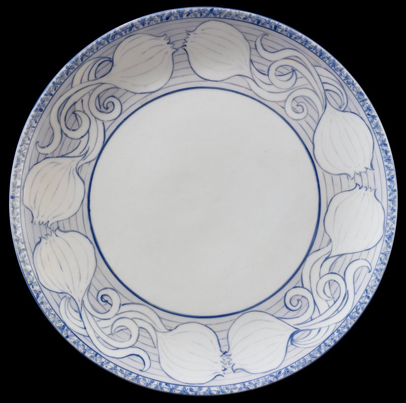 "blue glaze on white; 1/4"" band of small flowers around rim; 1 3/4"" band decorated with sprouted onions intertwining at four points with blue lines behind; undecorated at center in 5 3/8"" diameter area"