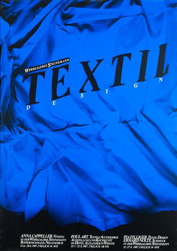 blue and black screened image of close-up of textile; black and white text; framed behind plexi with black frame