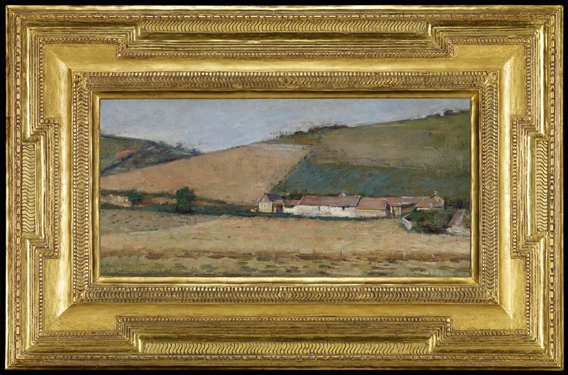 line of farm buildings at L surrounded by fields and hillside; pale blue sky; large gold frame