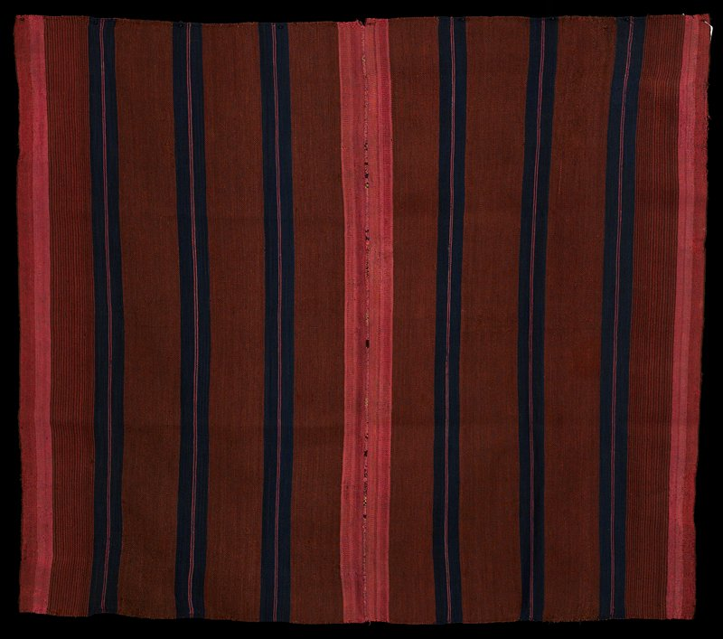 two pieces sewn together; dark pink and dark red with pink and blue stripes; warp faced plain weave