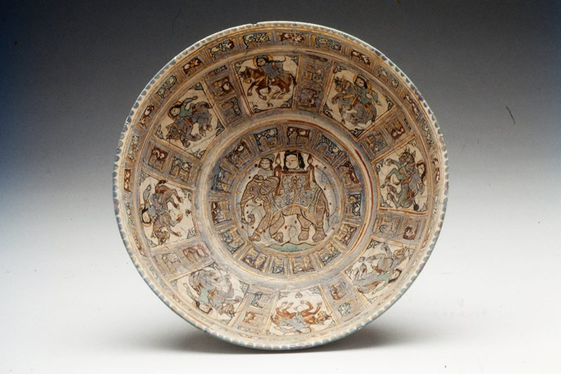 Bowl. Lady on an elephant. Mounted attendants. Polychrome overglaze. Minai type. Earthenware