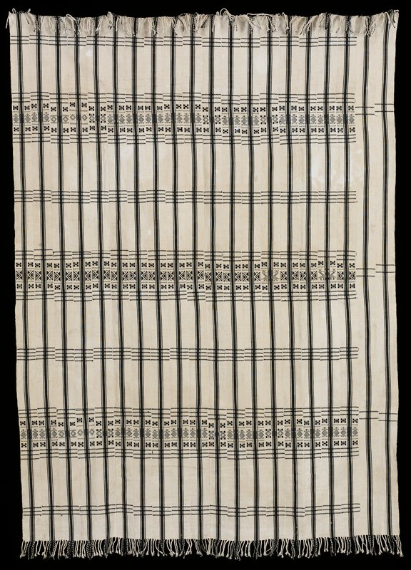 tan and black/brown; 20 strips of tan fabric with three stripes of black/brown lengthwise; center stripe wide, side stripes narrower; three wide sections of horizontal geometric pattern and four additional sets of three horizontal stripes; final two strips of fabric do not have complete design; fringed at both ends