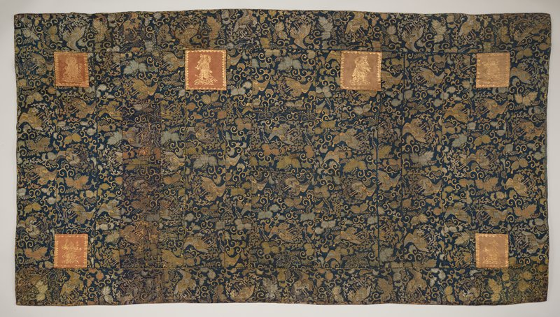 rectangular panel of blue silk with metallic gold and silver brocade designs of birds, leaves and scrolling vines; six squares of rose-colored silk with gold brocade designs of deities; purple silk backing