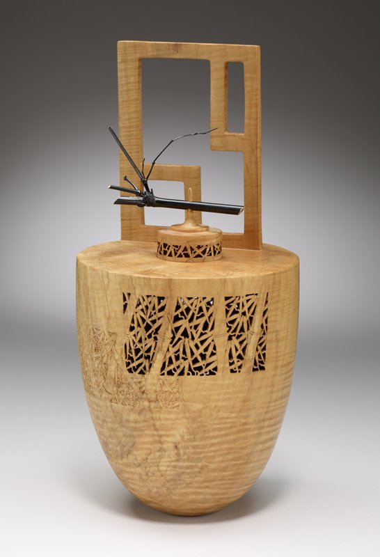 """03-10; conical structure with raised openwork rectangular shape on one side of top; small hole at top with removable lid that has black painted bamboo stick pierced by pointed top spire; two """"screens"""" of openwork carving at either side of top of body and a few areas of low-relief carving of bamboo trees and leaves"""