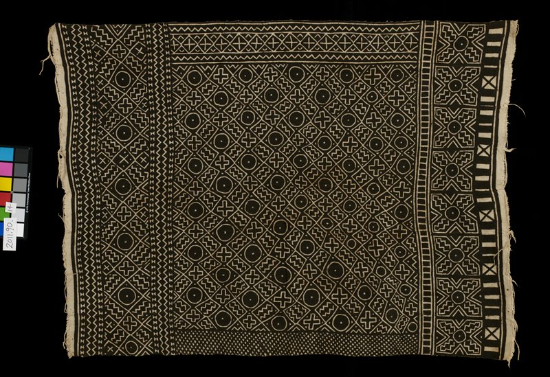 8 panels; brown and white printed design; circles, squares, triangles, x's and zig zag lines; center section with wide broders each with different apttern but same motifs