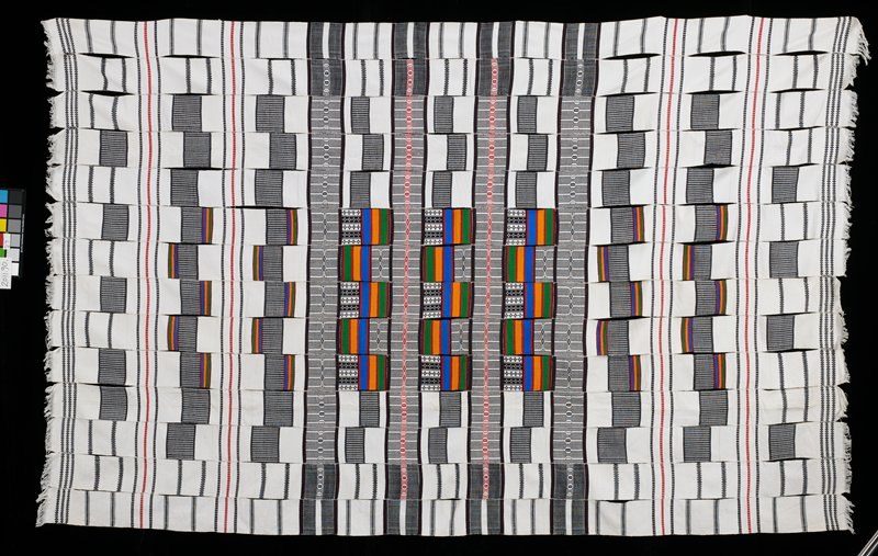 14 panels of woven multicolored striped patches; black and white abstract designs and white sections; white fringe on short edges; whole strips with mostly black and white patterns; strips loosely sewn together with many stitches undone