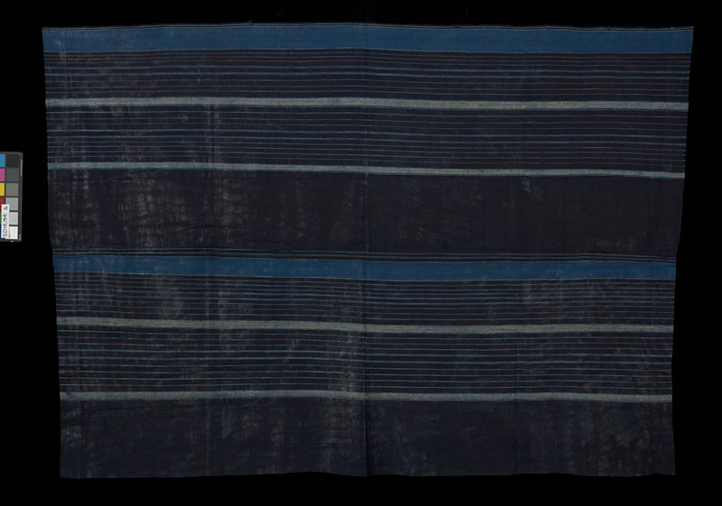 blue textile with light blue and grey stripes; stripes vary in width; short edges of textile hemmed; textile constructed of two panels