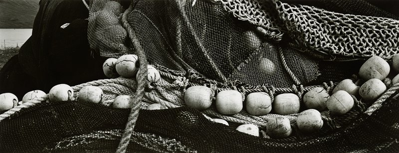 fishing nets with cracked, worn ovoid weights