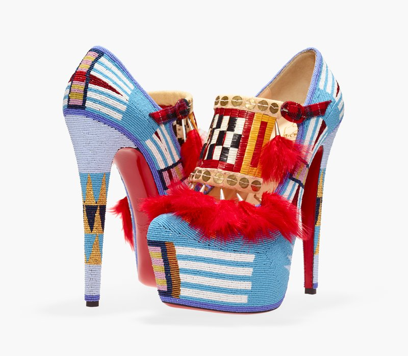 high-heeled platform Mary Jane-style shoes embellished with beading overall; predominately light blue beads with geometric designs; gold, medium blue and dark blue triangles on heels; kiltie extending below strap made of vertical bands of porcupine quills with a black and white checkerboard design at center edged in yellow and red; ten tassels of red feathers and tin cones on kilties; soles of shoes are red; shoes are Lady Daf 160 mm Tartan, designed by Christian Louboutin