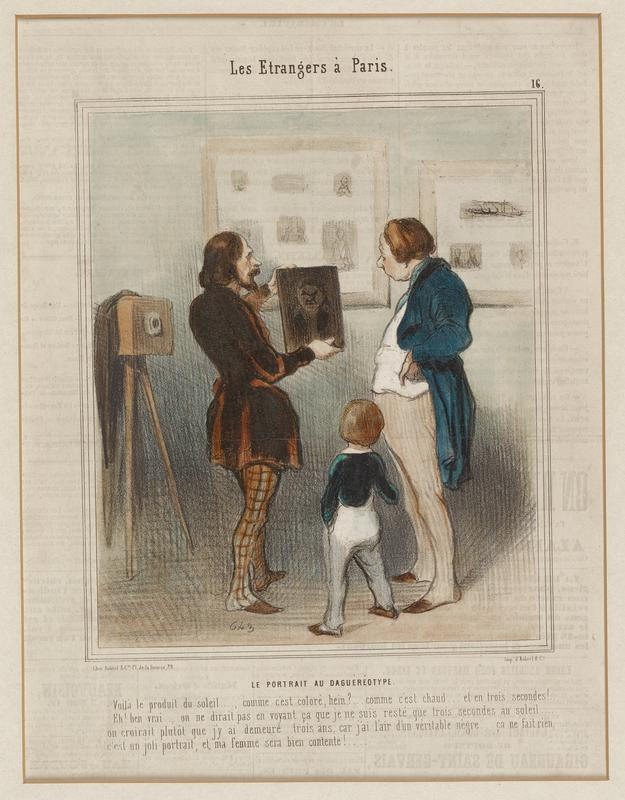 man in brown cloak and checked brown pants and left holding a daguerreotype; man at right in blue coat with tan striped pants looks at photograph; little boy wearing blue pants and green jacket at center, seen from back; camera on tripod at left