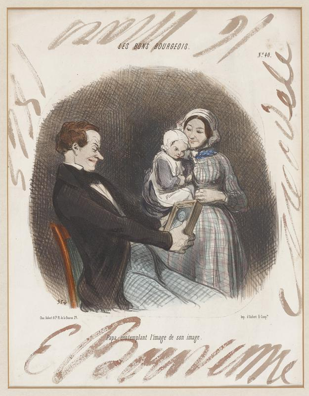 seated man wearing a black coat and blue checked pants, looking at a picture that he holds; woman wearing a plaid dress and a bonnet holding a child in a pinafore and bonnet standing at right; large, loose, cursive hand-written inscriptions at each edge in margins in brown watercolor
