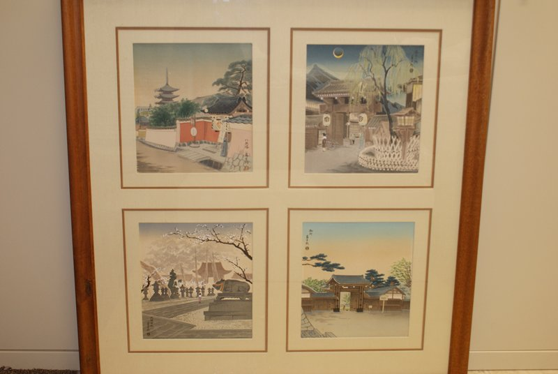 plum blossoms at Kitano: female figure in purple standing on stone pathway near statue of a bull with red and yellow cords around its neck and snout; stone lanterns line the pathway in background; white blossoming trees in background; larger branch with white blossoms cuts across image at UR