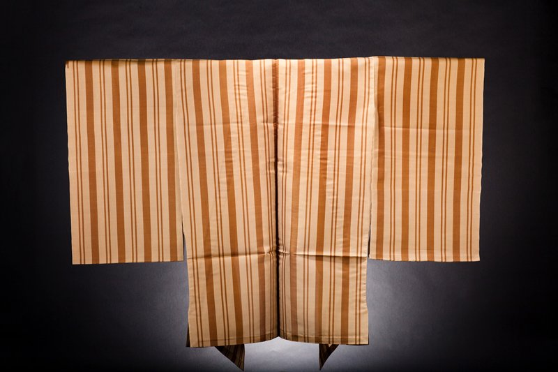 tan background with thick and thin vertical brown stripes; unlined