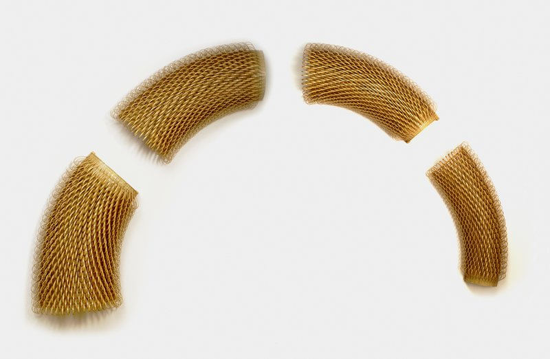 4 curved forms covered in thin bamboo loops; assembled together to create an arched shape