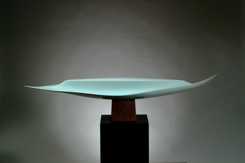 concave petal-like light blue form with inward curving edges; mounts horizontally onto wooden block base