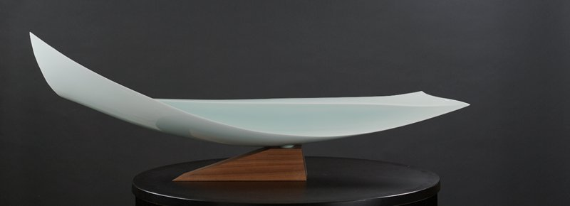 horizontally oriented finlike form; rectangular form rising slightly at center