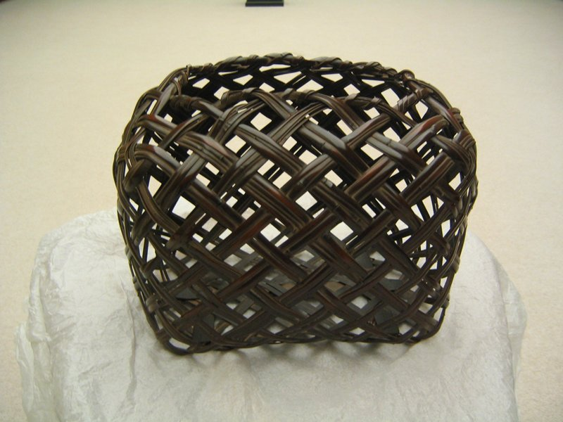rectangular basket with very open weave; bulbous sides, narrowing at top; rectangular opening